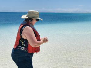 Debbie Fox releases flowers to the ocean in honor of fallen veterans.